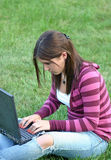 Girl Using Laptop. Girl on laptop computer outdoors Stock Images