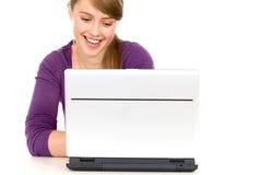 Girl using laptop Royalty Free Stock Image