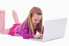 Girl using a laptop Royalty Free Stock Image