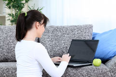 Girl using laptop Stock Image