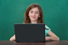 Girl Using Laptop In Classroom Royalty Free Stock Images