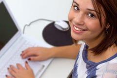 Girl using laptop computer. Modern young woman woking on laptop Royalty Free Stock Photo