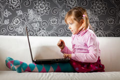 Girl using laptop computer Stock Photography
