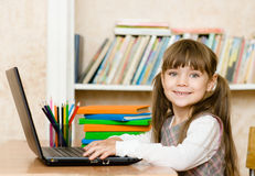 Girl using a laptop computer at school Royalty Free Stock Photos