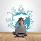 Girl using laptop with creative drawing environment concept. Little girl sitting on the floor with using laptop computer with creative drawing environment with stock images