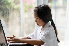 Girl Using Laptop at home Stock Photography