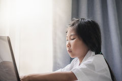 Girl Using Laptop at home Stock Photo