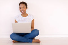 Girl using laptop home Royalty Free Stock Images