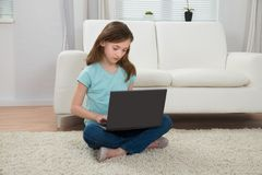 Girl Using Laptop In Living Room Stock Images