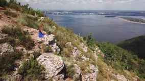 Girl using laptop on nature , aerial view of mountain. Girl using laptop,aerial view of beaurtiful nature and rocks, river and city stock footage