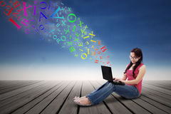 Girl using a laptop outdoor Stock Photos