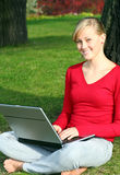 Girl using laptop outdoors Royalty Free Stock Photos