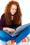 Girl is using laptop Stock Image