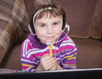 Girl Using Laptop. Royalty Free Stock Photography