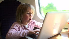 Girl Using Laptop On Train stock footage