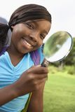 Girl Using Magnifying Glass Royalty Free Stock Photos