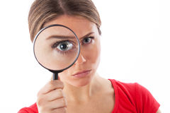 Girl using magnifying glass Royalty Free Stock Image