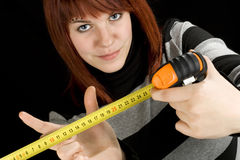 Girl using a measuring tape tool stock images