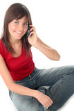 Girl using a mobile phone royalty free stock photo