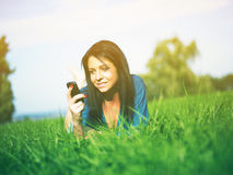 Girl using mobile phone in park Stock Image