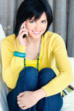 Girl using mobile phone. Pretty girl using mobile phone at home Stock Photography