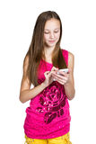 Girl using a mobile phone Stock Image