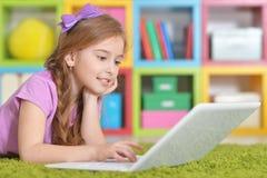 Girl using modern laptop Royalty Free Stock Photos