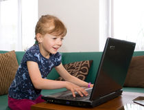 Girl using notebook Royalty Free Stock Photography