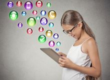 Girl using pad computer Royalty Free Stock Photos