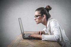 Girl using a pc at work stock photos