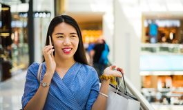Girl using phone while doing shopping Royalty Free Stock Photography