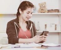 Girl using phone Royalty Free Stock Image