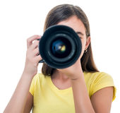 Girl using a professional camera isolated on white Royalty Free Stock Photography