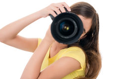 Girl using a professional camera isolated on white Royalty Free Stock Photos