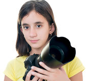 Girl using a professional camera isolated on white Royalty Free Stock Images