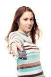 Girl using remote control Royalty Free Stock Photography