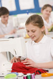 Girl using a sewing machine Stock Photography