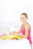 Girl using sewing machine to sew clothing Royalty Free Stock Photos