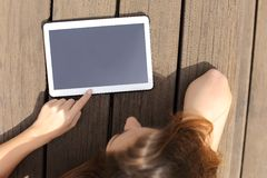 Girl using and showing a blank tablet screen Royalty Free Stock Images