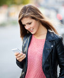 Girl using smart phone Royalty Free Stock Image