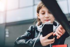 Girl using smart phone outdoor Stock Image