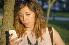 Girl using a smart phone stock photo