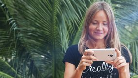 Girl using smartphone in terrace. Beautiful  young stock video