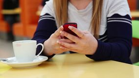 Girl Using Smartphone To Send  Message stock video footage