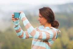 Girl using smartphone Royalty Free Stock Photos