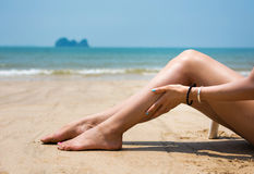 Girl using sun lotion on the beach Royalty Free Stock Photography