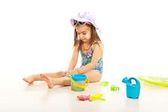 Girl using sunblock cream stock photo