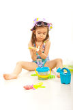 Girl using sunblock lotion stock image