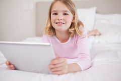 Girl using a tablet computer Royalty Free Stock Photos