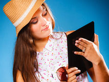 Girl using tablet computer e-book reader. Royalty Free Stock Photo